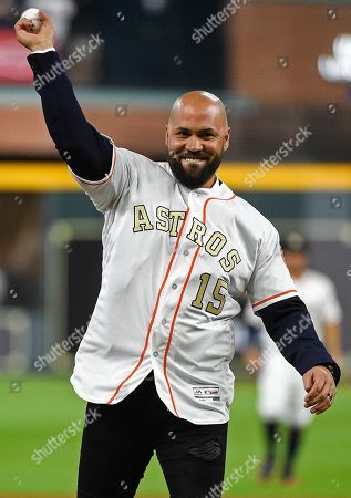 Former Houston Astros player Carlos Beltran throws out the ceremonial first pitch before the team's baseball game against the Baltimore Orioles, in Houston