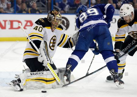 Tuukka Rask, Kevan Miller, Cory Conacher. Boston Bruins goaltender Tuukka Rask (40) makes a save on a shot by Tampa Bay Lightning center Cory Conacher (89) as defenseman Kevan Miller (86) defends during the second period of an NHL hockey game, in Tampa, Fla