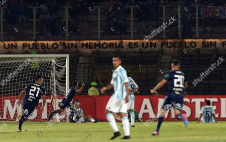 David Pizarro of Chile's Universidad of Chile, behind second from left, celebrates his goal against Argentina's Racing during a Copa Libertadores soccer match in Santiago, Chile
