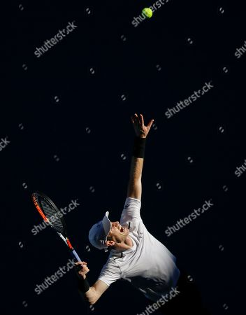 Britain's Andy Murray serves to Ukraine's Illya Marchenko during their first round match at the Australian Open tennis championships in Melbourne, Australia