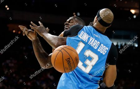 Stock Photo of Jerome Williams, Ivan Johnson. Ghost Ballers' Ivan Johnson loses control of the ball as The Power's Jerome Williams (13) defends during the first half of Game 1 in the BIG3 Basketball League in Philadelphia, Pa