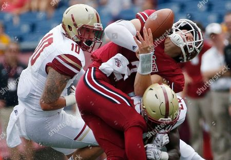 Isaac Yiadom, Ross Comis. Massachusetts quarterback Ross Comis (2) fumbles the ball as he is hit by Boston College defensive back Isaac Yiadom, bottom right, during the second quarter of an NCAA college football game in Foxborough, Mass., Saturday, Sept.10, 2016