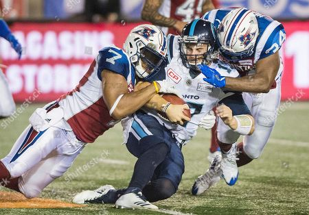 Cody Fajardo, John Bowman, Kyries Hebert. Toronto Argonauts quarterback Cody Fajardo, center, is tackled by Montreal Alouettes' John Bowman (7) and Kyries Hebert during the second half of a Canadian Football League game, in Montreal