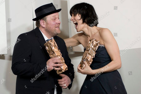 """French actors Gregory Gadebois, left, and Clotilde Hesme joke with their Cesar of Newcomer actor awards for the movie """"Angele et Tony"""" during the 37th French Cesar Awards ceremony, in Paris"""