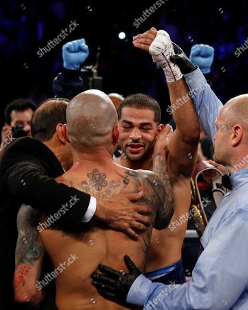 Miguel Cotto, Sadam Ali. Sadam Ali, right, is congratulated by Miguel Cotto after defeating Cotto in a WBO junior middleweight title boxing match, early, in New York