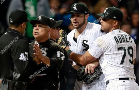 Lucas Giolito, Gabe Morales, Rick Renteria, Jose Abreu. Chicago White Sox manager Rick Renteria (17) argues with umpire Gabe Morales (47) as Jose Abreu (79) holds back starting pitcher Lucas Giolito after Giolito was thrown out of a baseball game by Morales during the sixth inning against the San Francisco Giants in Chicago