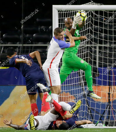 Costa Rica goalkeeper Patrick Pemberton, back, catches the ball during a CONCACAF Gold Cup semifinal soccer match against United States in Arlington, Texas