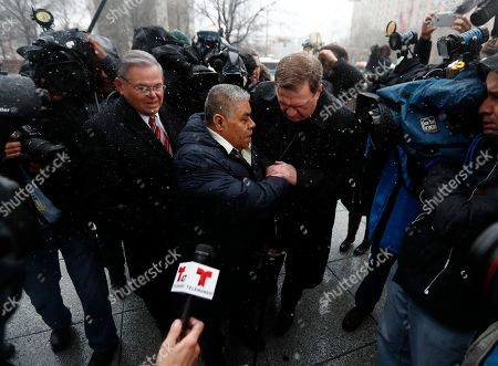 Catalino Guerrero, center, talks to Newark Archbishop Cardinal Joseph Tobin, right, as U.S. Sen. Bob Menendez, left, looks on moments before Guerrero entered the Peter Rodino Federal Building for an immigration hearing, in Newark, N.J. Guerrero, who arrived in the U.S. illegally in 1991, is facing deportation. Organizers claim he is an upstanding citizen and should not be deported