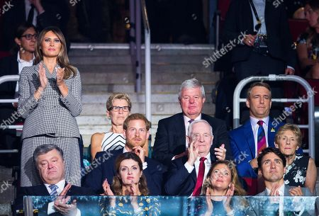 Melania Trump, Petro Poroshenko, Maryna Poroshenko, Sophie Gregoire-Trudeau, Justin Trudeau, Prince Harry, David Johnston, Sharon Johnston, Kathleen Wynne, Keith Mills, Michael Burns. First lady of the United States Melania Trump, second row left, takes in the opening ceremonies of the Invictus Games in Toronto, . Front row from left, Petro Poroshenko, President of Ukraine, Maryna Poroshenko, first lady of Ukraine, Sophie Gregoire-Trudeau, and Justin Trudeau, Prime Minister of Canada, middle row from left, Melania Trump, first lady of the United States, Britain's Prince Harry, David Johnston, Governor General of Canada, and Sharon Johnston, back row from left, Kathleen Wynne, Premier of Ontario, Sir Keith Mills, Chairman of the Invictus Games Foundation and Michael Burns, CEO of IG2017