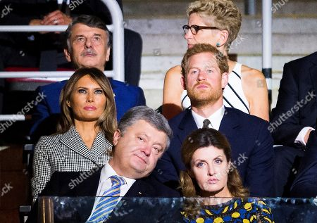 Prince Harry, Melania Trump, Maryna Poroshenko, Ralf Speth, Kathleen Wynne. Britain's Prince Harry, middle row right, takes in the opening ceremonies of the Invictus Games in Toronto on . Front row from left, Petro Poroshenko, President of Ukraine, Maryna Poroshenko, first lady of Ukraine, middle row from left, Melania Trump, first lady of the United States, and Prince Harry, back row from left, Dr. Ralf Speth, CEO Jaguar Land Rover, and Kathleen Wynne, Premier of Ontario