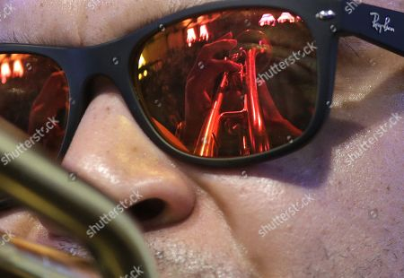 Stock Photo of The hands and trumpet of jazz recording artist Irvin Mayfield are felted in his glasses as he performs at the New Orleans Jazz and Heritage Festival in New Orleans
