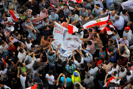 Egyptians celebrate the victory of Mohammed Morsi in the country's presidential election, at Tahrir Square in Cairo, Egypt, . Mohammed Morsi was declared Egypt's first Islamist president on Sunday after the freest elections in the country's history, narrowly defeating Hosni Mubarak's last Prime Minister Ahmed Shafiq in a race that raised political tensions in Egypt to a fever pitch