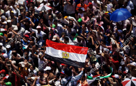 Egyptian celebrate the victory of President Mohammed Morsi in the presidential elections, in Tahrir Square, Cairo, Egypt, . Mohammed Morsi was declared Egypt's first Islamist president on Sunday after the freest elections in the country's history, narrowly defeating Hosni Mubarak's last Prime Minister Ahmed Shafiq in a race that raised political tensions in Egypt to a fever pitch
