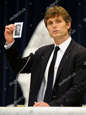 Stock Picture of Anthony Shriver holds up a photograph of his father, R. Sargent Shriver, during his father's funeral Mass at Our Lady of Mercy Catholic church in Potomac, Md., just outside Washington . Shriver, an in-law of the Kennedys, and the first director of the Peace Corps, died Tuesday. He was 95