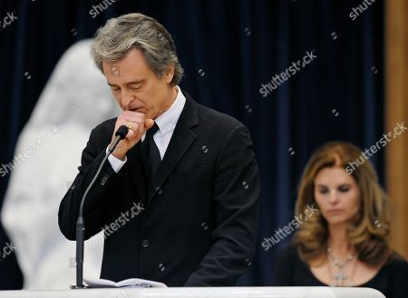 "Stock Picture of Robert Bobby Shriver, Maria. Robert ""Bobby"" Shriver III pauses while speaking about his father, R. Sargent Shriver, at his father's funeral Mass at Our Lady of Mercy Catholic church in Potomac, Md., just outside Washington . Shriver, an in-law of the Kennedys, and the first director of the Peace Corps, died Tuesday. He was 95. At right is Bobby's sister, Maria Shriver"