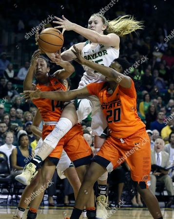 Stock Picture of Lauren Cox, Braxtin Miller, LaTashia Jones. Baylor forward Lauren Cox, center, reaches for a loose ball with Oklahoma State guard Braxtin Miller, left, and forward LaTashia Jones, right, during the second half of an NCAA college basketball game, in Waco, Texas. Baylor won 77-64