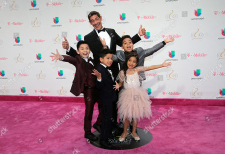Johnny Lozada and Peque Flow pose on the red carpet before the Premio Lo Nuestro Latin Music Awards, in Miami