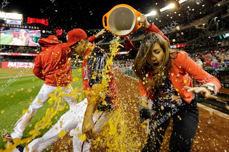 Julie Alexandria, Gio Gonzalez, douse sports drink cooler. Washington Nationals starting pitcher Gio Gonzalez, second from left, and MASN's sideline reporter Julie Alexandria react after getting a dunking of Gatorade after a baseball game at Nationals Park, in Washington. The Nationals won 8-1