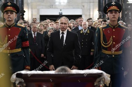 Russian President Vladimir Putin, center, attends a farewell ceremony for the Russian Ambassador to Turkey Andrei Karlov at the Foreign Ministry headquarters in Moscow, Russia, . Karlov was fatally shot by a Turkish policeman Monday in a gathering in Ankara, Turkey