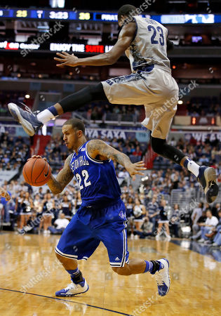 Aaron Bowen, Brian Oliver. Seton Hall guard/forward Brian Oliver (22) dodges around a leaping Georgetown forward Aaron Bowen (23) during the first half of an NCAA college basketball game, in Washington