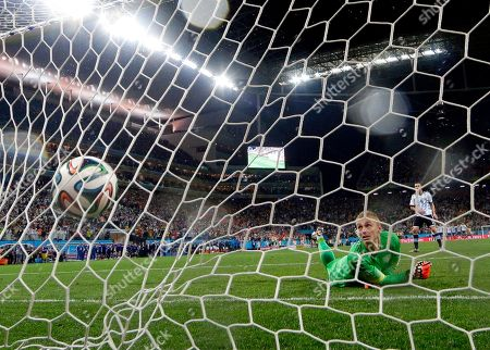 Argentina's Maxi Rodriguez shoots the winning shot against Netherlands' goalkeeper Jasper Cillessen during a penalty shootout after extra time during the World Cup semifinal soccer match between the Netherlands and Argentina at the Itaquerao Stadium in Sao Paulo Brazil, . Argentina defeated the Netherlands 4-2 in a penalty shootout after a 0-0 tie to advance to the finals
