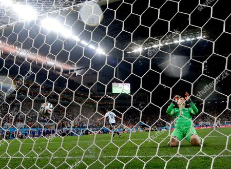 Netherlands' goalkeeper Jasper Cillessen reacts after Argentina's Maxi Rodriguez scored the winning goal during a penalty shootout after extra time during the World Cup semifinal soccer match between the Netherlands and Argentina at the Itaquerao Stadium in Sao Paulo Brazil, . Argentina defeated the Netherlands 4-2 in a penalty shootout after a 0-0 tie to advance to the finals