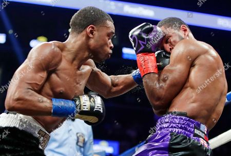 Stock Photo of Errol Spence Jr., Lamont Peterson. Errol Spence Jr., left, punches Lamont Peterson during the fourth round of an IBF welterweight championship boxing match, in New York. Spence won in the eighth round
