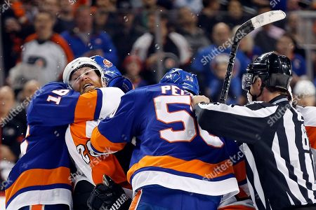 Claude Giroux, Andrew Ladd, Adam Pelech. Philadelphia Flyers center Claude Giroux (28) fights with New York Islanders left wing Andrew Ladd (16) and Islanders defenseman Adam Pelech (50) after the conclusion of their NHL hockey game in New York, . The Islanders won 5-4