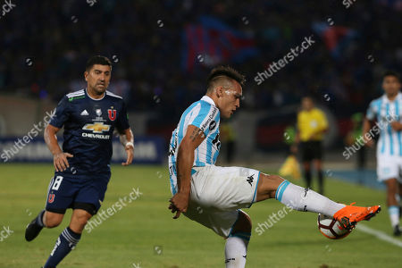 Lautaro Martinez of Argentina's Racing, right, controls the ball as David Pizarro of Chile's Universidad of Chile looks on during a Copa Libertadores soccer match in Santiago, Chile