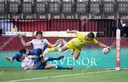 Jeremy Aicardi, Terry Bouhraoua, Edward Jenkins. Australia's Edward Jenkins, right, scores a try as France's Jeremy Aicardi, top left, and Terry Bouhraoua collide during a World Rugby Sevens Series match in Vancouver, British Columba., on