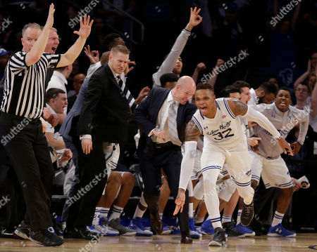 Seton Hall guard Derrick Gordon (32) reacts after hitting a 3-point shot near the end of the team's NCAA college basketball game against Creighton during the Big East men's tournament, in New York. Seton Hall won 81-73