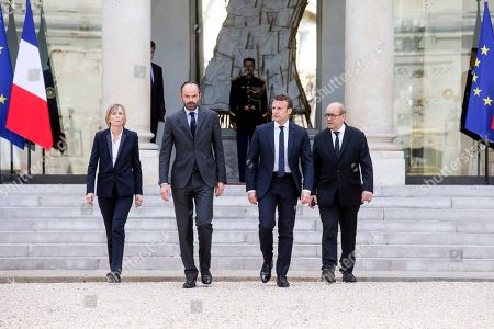 French President Emmanuel Macron, 2nd right, French Minister for European Affairs Marielle de Sarnez, left, French Prime Minister Edouard Philippe and French Foreign Affairs Minister Jean-Yves Le Drian, right, leave the Elysee Palace as they walk to the British embassy in Paris to present their condolences to the British ambassador to France, Edward Llewellyn, . An apparent suicide bomber attacked an Ariana Grande concert as it ended Monday night, killing over a dozen of people among a panicked crowd of young concertgoers