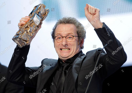 """Stock Picture of French cinematographer Guillaume Schiffman reacts after winning the Best Cinematography award for French director Michel Hazanavicius' film """"The Artist"""" during the 37th French Cesar Awards ceremony, at the Theatre du Chatelet in Paris"""