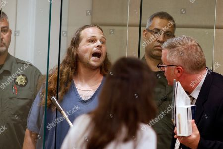 Jeremy Joseph Christian shouts as he is arraigned in Multnomah County Circuit Court in Portland, Ore., . Authorities say Christian started verbally abusing two young women, including one wearing a hijab. When three men on the train intervened, police say, Christian attacked them, killing two and wounding one
