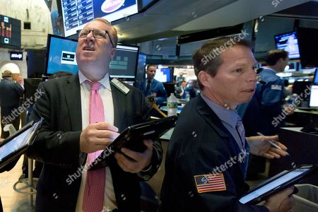 Daniel Ryan, Robert Charmak. Trader Daniel Ryan, left, and Robert Charmak work at the post that handles Pandora on the floor of the New York Stock Exchange, . Pandora, under intensifying pressure from Spotify and Apple Music, said Tuesday that CEO Tim Westergren has stepped down from that role
