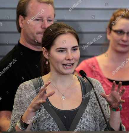 Stock Photo of As her father Curt Knox, left, looks, Amanda Knox briefly addresses a news conference shortly after her arrival at Seattle-Tacoma International Airport, in Seattle. It's been four years since the University of Washington student left for the study abroad program in Perugia and landed in prison. The group Friends of Amanda Knox and others have been awaiting her return since an Italian appeals court on Monday overturned her conviction of sexually assaulting and killing her British roommate, Meredith Kercher