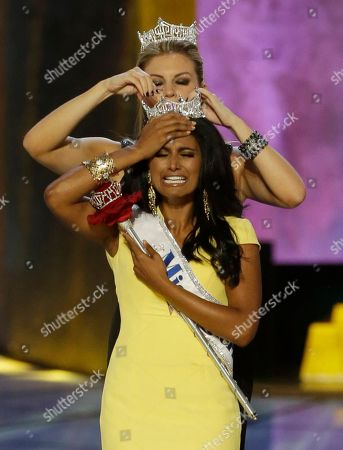 Stock Picture of Mallory Hagan, Nina Davuluri. Miss New York Nina Davuluri, front, is crowned as Miss America 2014 by Miss America 2013 Mallory Hagan, in Atlantic City, N.J