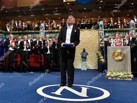 Stock Picture of Laureate in Literature Kazuo Ishiguro after receiving the award from King Carl Gustaf of Sweden during the 2017 Nobel prize award ceremony at the Concert house in Stockholm