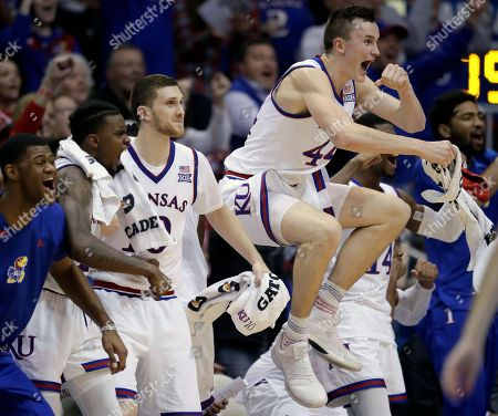 Stock Image of Mitch Lightfoot, Billy Preston, Lagerald Vick, Sviatoslav Mykhailiuk. Kansas forward Mitch Lightfoot (44) leaps from the bench to celebrate a teammate's basket during the second half of an NCAA college basketball game against Omaha in Lawrence, Kan., . Kansas forward Billy Preston, left, joins with guards Lagerald Vick (2) and Sviatoslav Mykhailiuk (10) in the celebration