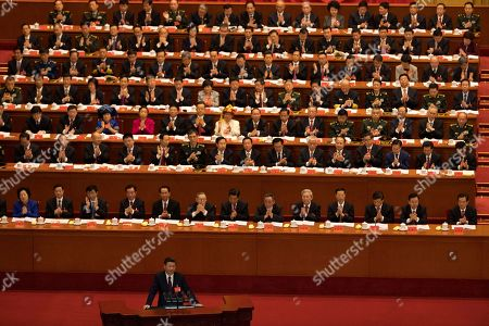 """Xi Jinping, Hu JIntao, Jiang Zemin. Chinese President Xi Jinping delivers a speech at the opening ceremony of the 19th Party Congress held at the Great Hall of the People in Beijing, China, . Chinese President Xi Jinping on Wednesday urged a reinvigorated Communist Party to take on a more forceful role in society and economic development to better address """"grim"""" challenges facing the country as he opened a twice-a-decade national congress"""