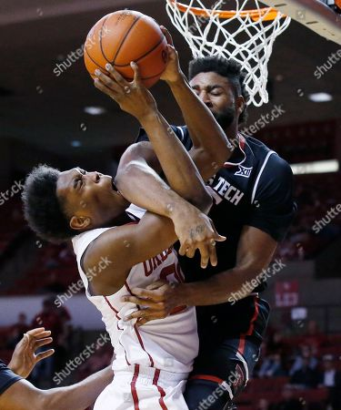 Kameron McGusty, Aaron Ross. Oklahoma guard Kameron McGusty, left, is fouled by Texas Tech forward Aaron Ross, right, on a shot during the second half of an NCAA college basketball game in Norman, Okla., . Oklahoma won 84-75