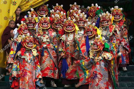 8dd92695e Tibetan Buddhist monks perform a dance called 'cham' wearing traditional  masks, at the