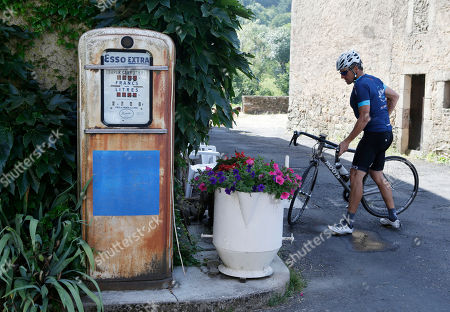 """Lance Armstrong parks his bike in Bouloc, during the charity ride """"Le Tour, One Day Ahead,"""" between Rodez and Mende, southern France, . While the Tour de France is going, Armstrong takes part to a charity ride called """"Le tour-One Day Ahead"""" with the goal of raising money to cure Leukemia"""
