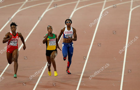 Stock Image of Jamaica's Veronica Campbell-Brown, center, runs in the lane of Britain's Margaret Adeoye, right, as they compete with Trinidad and Tobago's Semoy Hackett in a women's 200m heat during the World Athletics Championships at the Bird's Nest stadium in Beijing