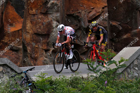 Stage winner France's Warren Barguil, wearing the best climber's dotted jersey, and France's Thomas Voeckler ride breakaway during the thirteenth stage of the Tour de France cycling race over 101 kilometers (62.8 miles) with start in Saint-Girons and finish in Foix, France