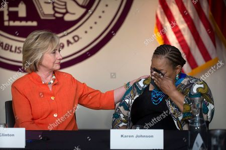 Hillary Rodham Clinton, Karen Johnson. Democratic presidential candidate Hillary Rodham Clinton, left, comforts home care consumer Karen Johnson who became emotional while sharing her story during a roundtable discussion home care, in Los Angeles