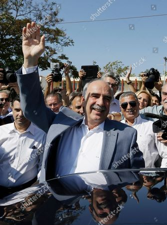 Leader of New Democracy main opposition party Vangelis Meimarakis waves to his supporters after casting his vote at a polling station in Athens, . Greeks were voting Sunday in their third national polls this year, called on to choose who they trust to steer the country into its new international bailout