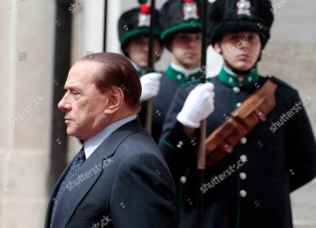 Silvio Berlsuconi. Italian Premier Silvio Berlusconi walks past honor guards prior to the start of his meeting with Joseph Deiss, President of the U.N. General Assembly, at Chigi palace, Premier's office, in Rome, . Berlusconi suffered a serious political blow in his native Milan when his candidate failed to win outright a mayoral race that the Italian leader had called a referendum on his government. Though down by a surprising 6.4 percentage points, according to final results Tuesday, incumbent Mayor Letizia Moratti still has a chance to retain her seat