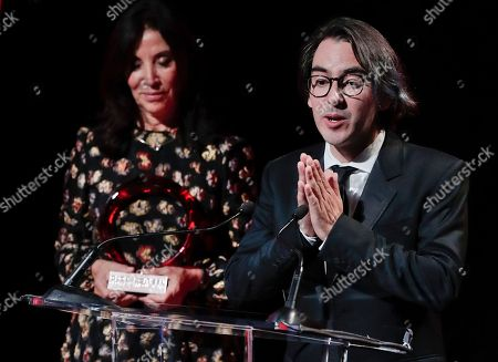 Dhani Harrison, Olivia Harrison. Dhani Harrison, right, son of George Harrison, and Olivia Harrison, George Harrison's wife, accept the Global Citizen Award awarded posthumously to George Harrison during the Global Citizen Festival concert, in New York