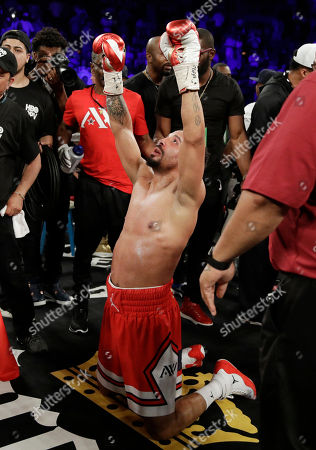 Andre Ward celebrates after defeating Sergey Kovalev during a light heavyweight championship boxing match, in Las Vegas